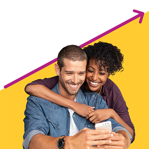 Couple hugging and happy about banking together as they smile at phone screen