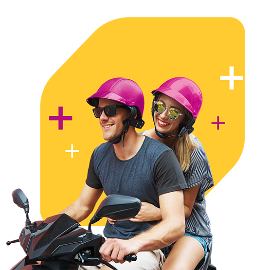 Couple on moped wearing sunglasses and matching pink helmets